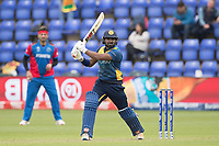 Kusal Perera (Sri Lanka) clubs the ball over extra cover for four  and brings up his half century during Afghanistan vs Sri Lanka, ICC World Cup Cricket at Sophia Gardens Cardiff on 4th June 2019