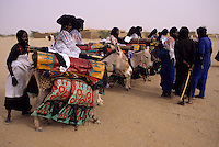 In-Gall, near Agadez, Niger - Tuareg Women, Preparing to attend a Wedding.  The Cure Salé, an Annual Gathering of Tuareg Nomads in the north of Niger, is a time for exchanging news, arranging weddings, and organizing for political and social purposes.