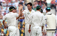 Mitchell Starc of Australia celebrates a wicket - England vs Australia - 5th day of the 5th Investec Ashes Test match at The Kia Oval, London - 25/08/13 - MANDATORY CREDIT: Rob Newell/TGSPHOTO - Self billing applies where appropriate - 0845 094 6026 - contact@tgsphoto.co.uk - NO UNPAID USE