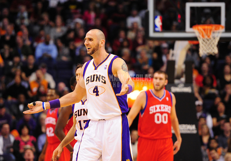 Dec. 28, 2011; Phoenix, AZ, USA; Phoenix Suns center Marcin Gortat (4) reacts during game against the Philadelphia 76ers at the US Airways Center. The 76ers defeated the Suns 103-83. Mandatory Credit: Mark J. Rebilas-USA TODAY Sports