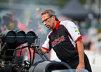 Aug 17, 2018; Brainerd, MN, USA; Crew members with NHRA top fuel driver Billy Torrence during qualifying for the Lucas Oil Nationals at Brainerd International Raceway. Mandatory Credit: Mark J. Rebilas-USA TODAY Sports