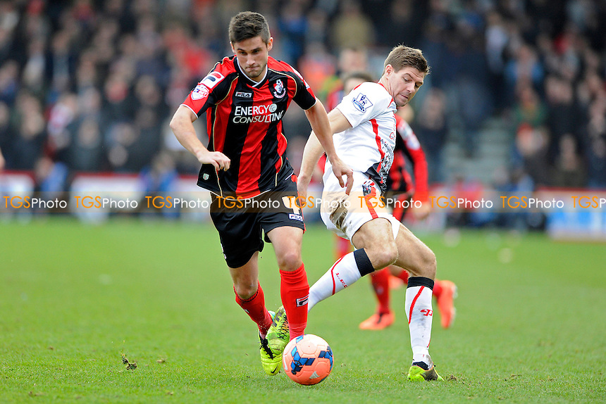 Andrew Surman of AFC Bournemouth skips past Steven Gerrard of Liverpool - AFC Bournemouth vs Liverpool - FA Cup 4th Round Football at the Goldsands Stadium, Bournemouth, Dorset - 25/01/14 - MANDATORY CREDIT: Denis Murphy/TGSPHOTO - Self billing applies where appropriate - 0845 094 6026 - contact@tgsphoto.co.uk - NO UNPAID USE