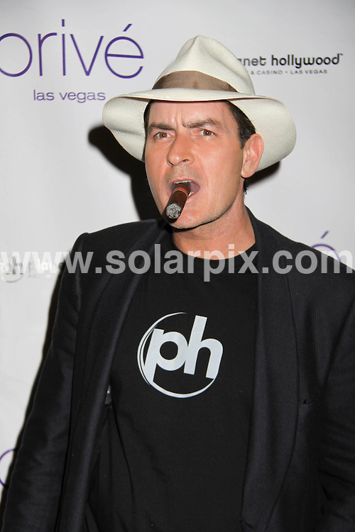 **ALL ROUND PICTURES FROM SOLARPIX.COM**.**SYNDICATION RIGHTS FOR UK, SPAIN, PORTUGAL, AUSTRALIA, S.AFRICA & DUBAI (U.A.E) ONLY**.The Hollywood comedy actor Charlie Sheen Hosts an Evening at Prive Las Vegas  at the Planet Hollywood Resort and Casino in Las Vegas,Nevada in the USA. ..JOB REF: 7701-PHZ/PRN    DATE:25_10_08 .**MUST CREDIT SOLARPIX.COM OR DOUBLE FEE WILL BE CHARGED* *UNDER NO CIRCUMSTANCES IS THIS IMAGE TO BE REPRODUCED FOR ANY ONLINE EDITION WITHOUT PRIOR PERMISSION*