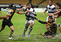 Jayden Hayward and Willie Ripa try to bring down Auckland halfback Taniela Moa. Air New Zealand Cup rugby match - Taranaki v Auckland at Yarrows Stadium, New Plymouth, New Zealand. Friday 9 October 2009. Photo: Dave Lintott / lintottphoto.co.nz