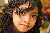 MR / Schenectady, NY. Zoller Elementary School (urban public school). Kindergarten inclusion classroom. Portrait of student (girl, 5) in classroom. MR: Ram13. ID: AM-gKw. © Ellen B. Senisi.