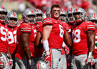 Members of the Ohio State defense, including Ohio State Buckeyes defensive end Sam Hubbard (6) wait for the result of a play being reviewed during the first quarter of Saturday's NCAA Division I football game at Ohio Stadium in Columbus on September 23, 2017. [Barbara J. Perenic/Dispatch]