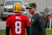Green Bay Packers quarterback Taysom Hill (8) and offensive perimeter coach David Raih during an Organized Team Activity on May 23, 2017 at Clarke Hinkle Field in Green Bay, Wisconsin.  (Brad Krause/Krause Sports Photography)