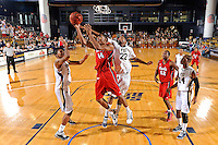 21 January 2012:  FIU center Brandon Moore (22) and guard-forward Dominique Ferguson (3) battle FAU guard-forward Kelvin Penn (44) for a rebound in the first half as the Florida Atlantic University Owls defeated the FIU Golden Panthers, 66-64, at the U.S. Century Bank Arena in Miami, Florida.
