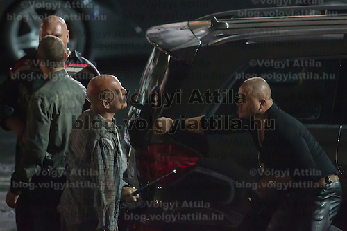 US actor Bruce Willis (front L) participates a rehearsal of a fight schene on set during a shooting of their next movie fifth in the Die Hard series titled Good Day to Die Hard in Budapest, Hungary on July 11, 2012. ATTILA VOLGYI