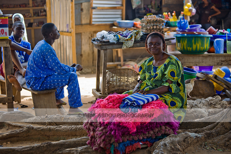 A woman sells colorful hand-knitted cloth in Abuja, Nigeria.