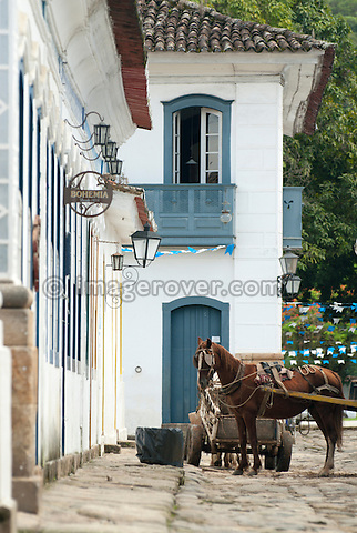 Horse cart in one of the charming roads of Paraty's historic centre; Paraty, Brazil. --- Info: The beautiful colonial town of Paraty has been a UNESCO World Heritage Site since 1958. --- No signed releases available.