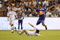 LA Galaxy midfielder Dema Kovalenko slides under advancing Dane Richards of the New York Red Bulls. The New York Red Bulls beat the LA Galaxy 2-0 at Home Depot Center stadium in Carson, California on Friday September 24, 2010.