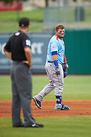 Tennessee Smokies first baseman Dan Vogelbach (21) looks to the third base coach as he leaves the field with an injury during a game against the Montgomery Biscuits on May 25, 2015 at Riverwalk Stadium in Montgomery, Alabama.  Tennessee defeated Montgomery 6-3 as the game was called after eight innings due to rain.  (Mike Janes/Four Seam Images)
