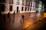 Protestors throw rocks at the windows of the state legislature building, in Rio de Janeiro, Brazil, Monday, June 17, 2013. Protests in Sao Paulo, Rio de Janeiro and other major Brazilian cities began with a 20-cent hike in public transport fares, have clearly moved beyond that issue to widespread frustration in Brazil about a heavy tax burden, politicians widely viewed as corrupt and woeful public education, health and transport systems and come as the nation hosts the Confederations Cup soccer tournament and prepares for next month's papal visit. <br /> <br /> Monday's demonstration brought a record 100,000 protestors who expressed their frustration at the heavy-handed policing, poor public services and high costs for the World Cup. The majority of Rio's protestors were peaceful, however a large group attacked the state legislature building, setting a car and other objects ablaze. Rio state security officials say at least 20 officers and 9 protesters were injured.