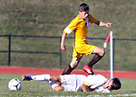 TERRYVILLE CT. 17 October 2017-101717SV07-#13 Adoni Pelz of Terryville goes down while battling for the ball with #2 Mergim Kutllovci of Thomaston during soccer action in Terryville Wednesday.<br /> Steven Valenti Republican-American