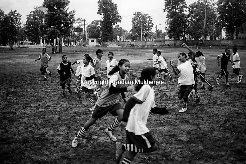 Students of Sukma Football academy train in their ground at the educational complex in Sukma.Sukma, Chattisgarh, India. Arindam Mukherjee