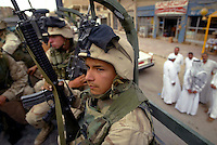 As Samawah--US Marines Lance Corporal Juan Medina keeps watch on the rooftops of buildings as the 2nd Batalliion of 5th Marines ride in the back of their truck during patrol.  As Samawah located about 180 Kilometers south of Baghdad was a town that suffered many setback during the war and is now on its way to rebuilding. There has been many obstacles for the people as they grow more and more impatient with the progress at the speed the US Military are carrying out civil affairs. .EDS NOTE: For story BY MEGAN STACK about As Samawah and the daily life in the city during this difficult time.