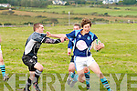 Killorglin RFC made the journey to Cahersiveen on Saturday last to take on Iveragh Eagles in the Foley Cup semi-final, pictured here Killorglin's Trevor West keeping Iveragh Eagles Fionán McCarthy at arms length.  Iveragh Eagles 7 Killorglin 34.