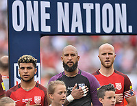 Commerce City, CO - Thursday June 08, 2017: DeAndre Yedlin, Tim Howard and Michael Bradley during the national anthem in their 2018 FIFA World Cup Qualifying Final Round match versus Trinidad & Tobago at Dick's Sporting Goods Park.