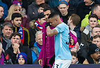 A tearful Gabriel Jesus of Manchester City is lead to the tunnel as he has to leave the pitch through a knee injury during the Premier League match between Crystal Palace and Manchester City at Selhurst Park, London, England on 31 December 2017. Photo by Andy Rowland.