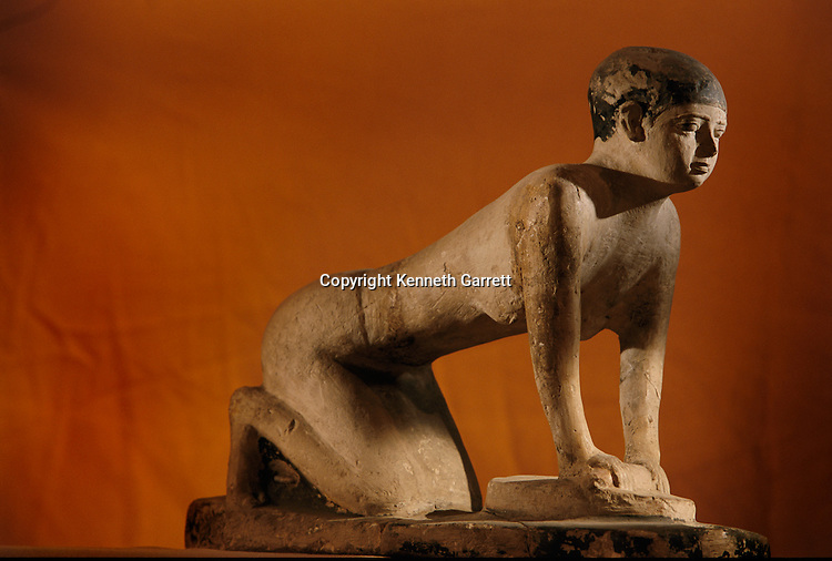 Painted limestone statue of a servant grinding grain, Old kingdom