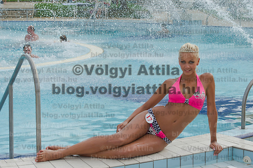 Szilvia Kalman poses for photographers after winning the Miss Bikini Hungary beauty contest held in Budapest, Hungary on August 06, 2011. ATTILA VOLGYI