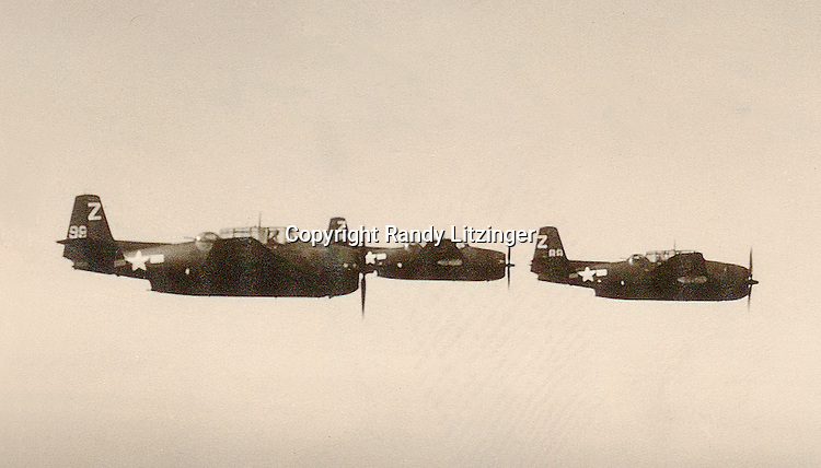 Torpedo Squadron 85 (VT-85) TBF Avengers flying over Japan waters. - July 1945 or later  -- Photo By Wade Litzinger