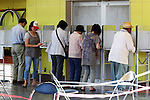 July 10, 2016, Tokyo, Japan - Voters choose candidates in Japan's Upper House election at a polling station in Tokyo on Sunday, July 10, 2016. Polling stations opened early across the nation in a Upper House election with 389 candidates vying for 121 seats.    (Photo by Yoshio Tsunoda/AFLO) LWX -ytd-