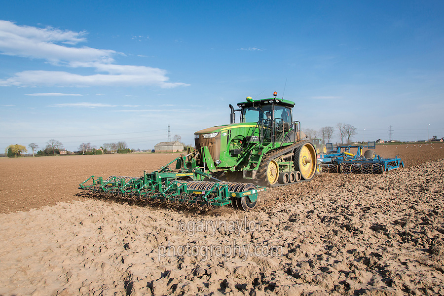 Cultivating sugar beet seed bed with a John Deere 8310RT and six meter Preperator - Lincolnshire, March