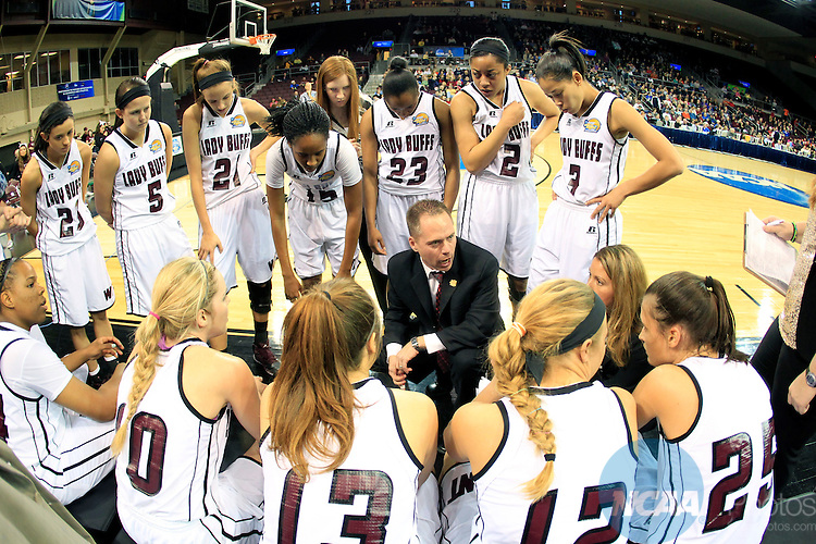 28 MAR 2014:   Mark Kellog head coach of West Texas A&M  talks to his team during a timeout during first half action against Bentley University during the Division II Women's Basketball Championship held at the Erie Insurance Arena in Erie, PA. Bentley defeated West Texas A&M 73-65 for the National title. Harry Scull Jr./NCAA Photos