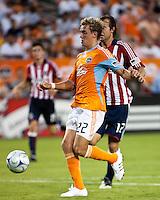 Houston Dynamo midfielder Stuart Holden (22) shoots the ball.  Houston Dynamo defeated CD Chivas USA 1-0 at Robertson Stadium in Houston, TX on June 10, 2009.