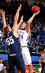 BROOKINGS, SD - NOVEMBER 3:  Mike Daum #24 from South Dakota State takes the ball to the basket against Tristan Von Nieda #55 from SD School of Mines in the first half of their exhibition game Thursday evening at Frost Arena in Brookings. (Photo by Dave Eggen/Inertia)