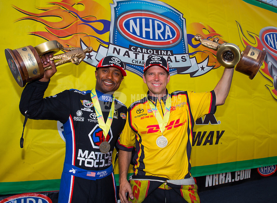 Sep 20, 2015; Concord, NC, USA; NHRA top fuel winner Antron Brown (left) celebrates with funny car winner Del Worsham following the Carolina Nationals at zMax Dragway. Mandatory Credit: Mark J. Rebilas-USA TODAY Sports