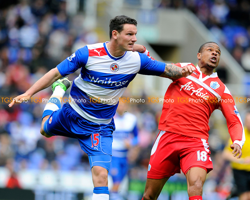 Sean Morrison of Reading and Loic Remy of QPR tussle - Reading vs QPR - Barclays Premier League Football at the Madejski Stadium, Reading, Berkshire - 28/04/13 - MANDATORY CREDIT: Denis Murphy/TGSPHOTO - Self billing applies where appropriate - 0845 094 6026 - contact@tgsphoto.co.uk - NO UNPAID USE.