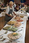 Priddy Friendly Society annual Club Walk Day. Somerset Uk 2019.<br /> Penny Tucker in charge of preparing the Friendly Society annual lunch.