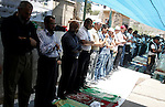 Palestinians pray in the Red Cross yard during the Friday prayer in East Jerusalem , Friday 16 July 2010, in solidarity with PLC members and former Palestinian minister Ahmad Atwon, Mohammad Totah and Khalid Abu Arfeh. After the Israeli authorities have threatened them with expulsion from Jerusalem because of their affiliation to Hamas, and after arresting their colleague Mohammed Abu Tair, the three had moved into the grounds of the International Red Cross in East Jerusalem in protest at the deportation orders.. Photo by Mahfouz Abu Turk