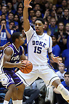 26 November 2014: Duke's Jahlil Okafor (15) guards Furman's John Davis III (1). The Duke University Blue Devils hosted the Furman University Paladins at Cameron Indoor Stadium in Durham, North Carolina in a 2014-16 NCAA Men's Basketball Division I game. Duke won the game 93-54.