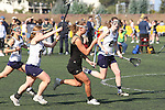 Santa Barbara, CA 02/18/12 - Katherine McKenna (UC Davis #11), Jessica Dresser (UC Davis #21) and unidentified Colorado State player(s) in action during the UC Davis - Colorado State game at the 2012 Santa Barbara Shootout.  Colorado State defeated UC Davis 10-9.