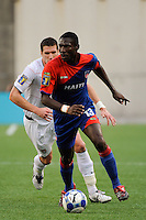 Pierre Bruny (13) of Haiti (HAI) is chased by Kenny Cooper (17) of the United States (USA). The United States and Haiti played to a 2-2 tie during a CONCACAF Gold Cup Group B group stage match at Gillette Stadium in Foxborough, MA, on July 11, 2009. .