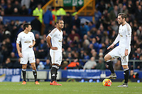 Wayne Routledge and Gylfi Sigurdsson look dejected after Everton equalise during the Barclays Premier League match between Everton and Swansea City played at Goodison Park, Liverpool