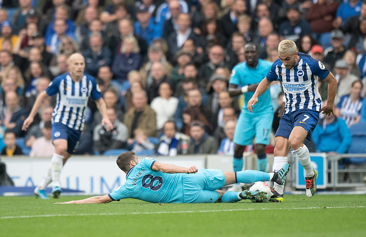 Brighton & Hove Albion's Neal Maupay (right) is tackled by Tottenham Hotspur's Harry Winks (left) <br /> <br /> Photographer David Horton/CameraSport<br /> <br /> The Premier League - Brighton and Hove Albion v Tottenham Hotspur - Saturday 5th October 2019 - The Amex Stadium - Brighton<br /> <br /> World Copyright © 2019 CameraSport. All rights reserved. 43 Linden Ave. Countesthorpe. Leicester. England. LE8 5PG - Tel: +44 (0) 116 277 4147 - admin@camerasport.com - www.camerasport.com