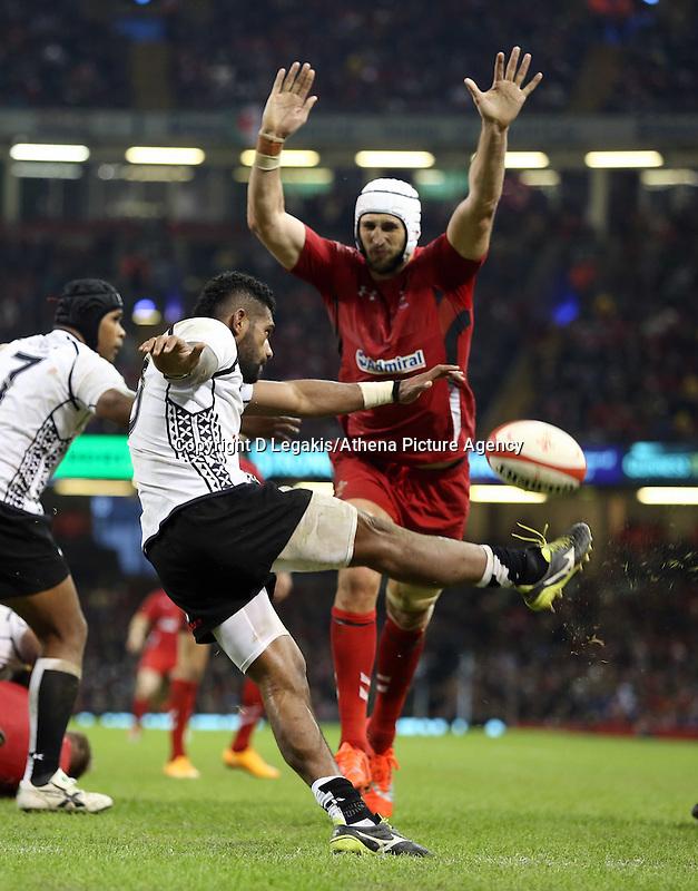 Pictured L-R: Nikola Matawalu of Fiji has his shot blocked by Luke Charteris of Wales. Saturday 15 November 2014<br /> Re: Dove Men Series rugby, Wales v Fiji at the Millennium Stadium, Cardiff, south Wales, UK.