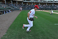 Center fielder Andrew Benintendi (2) of the Greenville Drive runs onto the field in a game against the Greensboro Grasshoppers on Wednesday, August 26, 2015, at Fluor Field at the West End in Greenville, South Carolina. Benintendi is a first-round pick of the Boston Red Sox in the 2015 First-Year Player Draft out of the University of Arkansas. Greenville won, 7-0. (Tom Priddy/Four Seam Images)