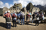 Tourists taking photos at the ruins of Machu Picchu, Peru.