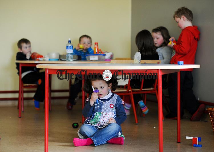 Little Leah Mc namara plays to the camera  at Carron National School. Photograph by John Kelly.