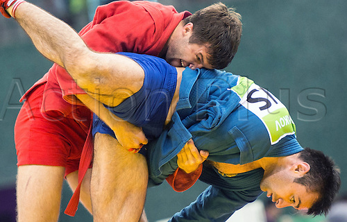 22.06.2015. Baku, Azerbaijan. 1st European Games. Azamat Sidakow of Russia (blue) fights against Stsiapan Papou (red) of Belarus during the Men's -74kg semifinals competition in Sambo at the Baku 2015 European Games in Baku, Azerbaijan