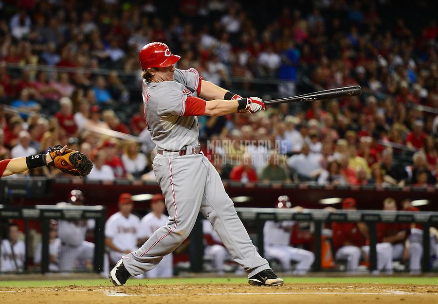 Aug. 28, 2012; Phoenix, AZ, USA: Cincinnati Reds catcher Ryan Hanigan hits a two run single in the second inning against the Arizona Diamondbacks at Chase Field. Mandatory Credit: Mark J. Rebilas-
