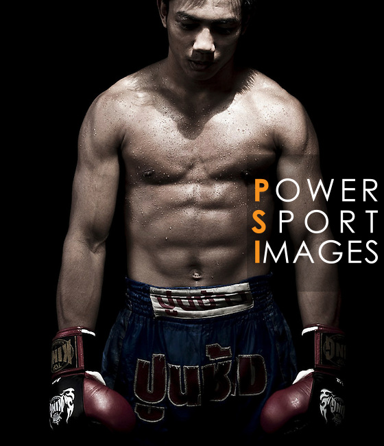 """Muay Thai Kickboxing figther poses at Sangmorakot gymnasium in Bangkok, Thailand. Muay Thai, also know as """"Art of Eight Limbs"""", is a hard martial art and Thailand's national sport. Photo by Victor Fraile --- Image by © Victor Fraile"""