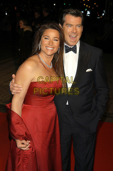 """KEELEY SHAYE SMITH & PIERCE BROSNAN .James Bond film premiere of """"Die Another Day"""", London, UK..November 18th, 2002.red satin strapless dress gown half length black tuxedo married husband wife mouth open.CAP/PL.©Phil Loftus/Capital Pictures"""