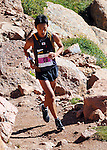 August 15, 2015 - Manitou Springs, Colorado, U.S. - Japan's Touru Miyahara carefully negotiates the final rocky steps to win the Pikes Peak Ascent during the 60th running of the Pikes Peak Ascent and Marathon.  During the Ascent, runners cover 13.3 miles and gain more than 7815 feet (2382m) by the time they reach the 14,115ft (4302m) summit.  On the second day of race weekend, 800 marathoners will make the round trip and cover 26.6 miles of high altitude and very difficult terrain in Pike National Forest, Manitou Springs, CO.
